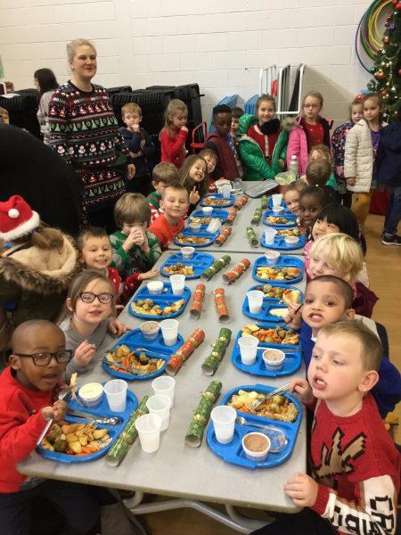 Children enjoying their Christmas lunch.