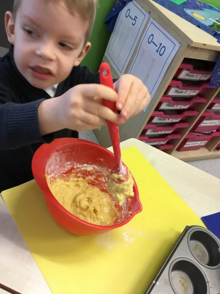 Children enjoying baking buns linked to our learning about light and dark.